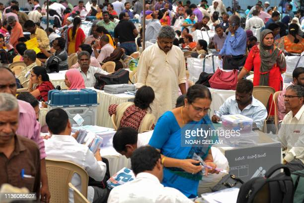 Indian election officials check polling material and Electronic Voting Machines at a distribution centre in Hyderabad on April 10 a day before the...