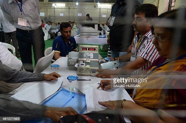 Indian election officials count votes using an Electronic Voting Machine at a counting centre in New Delhi on May 16 2014 Hindu nationalist Narendra...