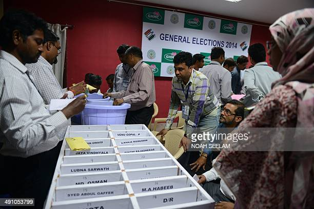 Indian election officials open postal ballots at a counting centre in Hyderabad on May 16 2014 Hindu nationalist Narendra Modi looked set to sweep to...