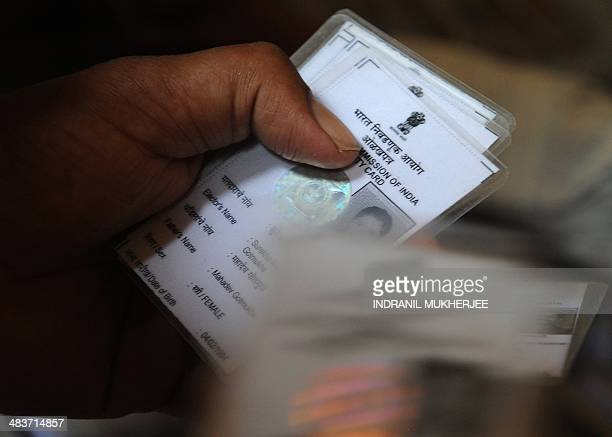 Indian election officials search for photo identity cards of voters at a centre in Mumbai on April 10 2014 Voters went to the polls in New Delhi on...