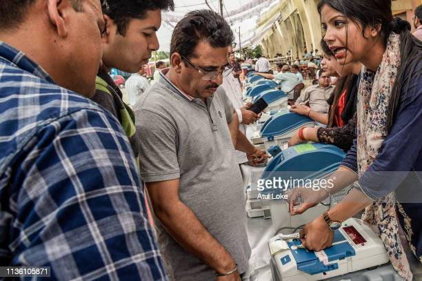 Indian elections worker learns how to operate voting machines at an Elections Commission facility before moving to a polling station on April 10 2019...