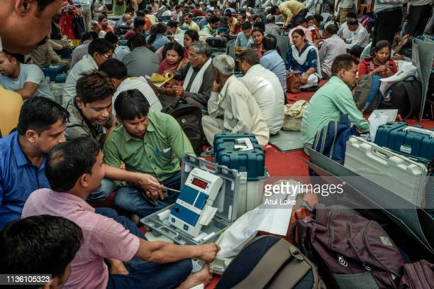 Indian elections workers collect voting machines and check them at an Elections Commission facility before moving to a polling station on April 10...
