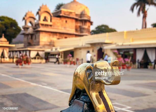 indian elephant and jag mandir island palace - buddhist goddess stock pictures, royalty-free photos & images