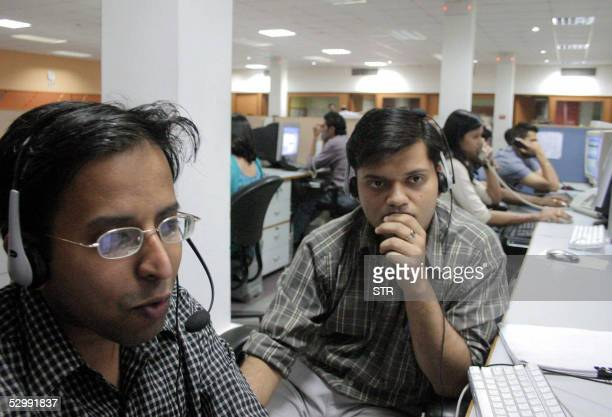 WITH 'INDIAITOUTSOURCING' Indian employees of the Quark call center work during their night shift late 09 May 2005 in Mohali in India's northern...
