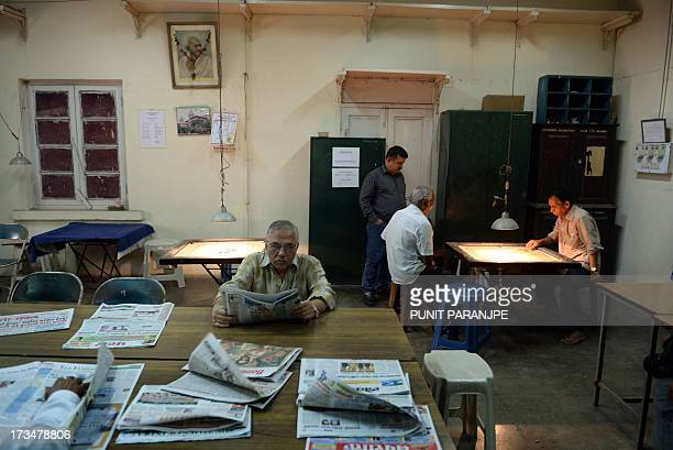 Indian employees spend time in the recreation room of the Central Telegraph Office in Mumbai on July 15 2013 After 162 years of connecting people...