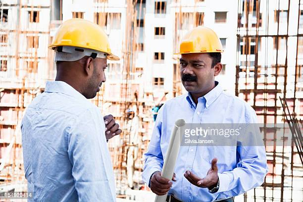 indian engineer architect on construction site