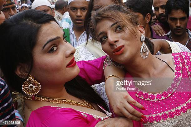 Indian eunuchs dance at a procession during the Urs festival at the shrine of Sufi saint Khwaja Moinuddin Chishti in Ajmer India