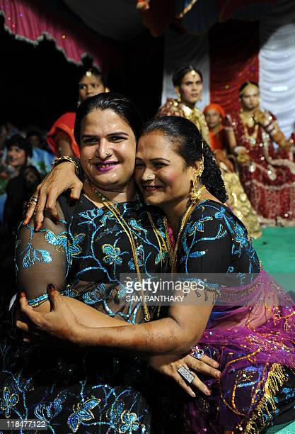 Indian eunuchs embrace during their wedding reception in Ahmedabad on July 12 2009 In the presence of some one hundred eunuchs of the association a...