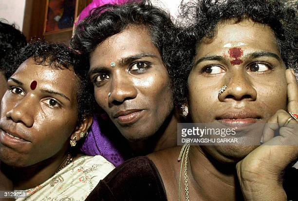 Indian eunuchs pose for photographers during a meeting to discuss a High Court Judgement in Madras 25 March 2004 Madras High Court issued a judgement...