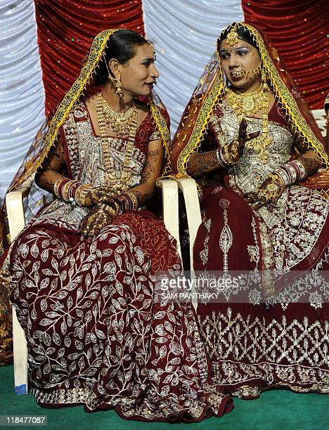 Indian eunuchs speak during their wedding reception in Ahmedabad on July 12 2009 In the presence of some one hundred eunuchs of the association a...