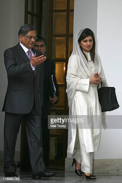 Indian External Affairs Minister SM Krishna with his Pakistani counterpart Hina Rabbani Khar during a meeting at Hyderabad House in New Delhi on...