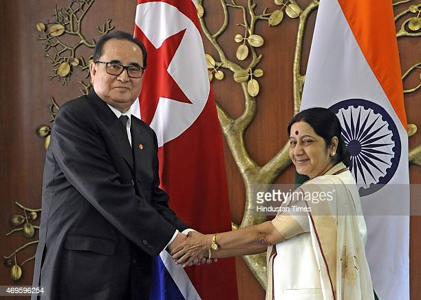 Indian External Affairs Minister Sushma Swaraj handshakes with North Korean Foreign Minister Ri SuYong during a meeting at Jawahar Lal Bhawan on...