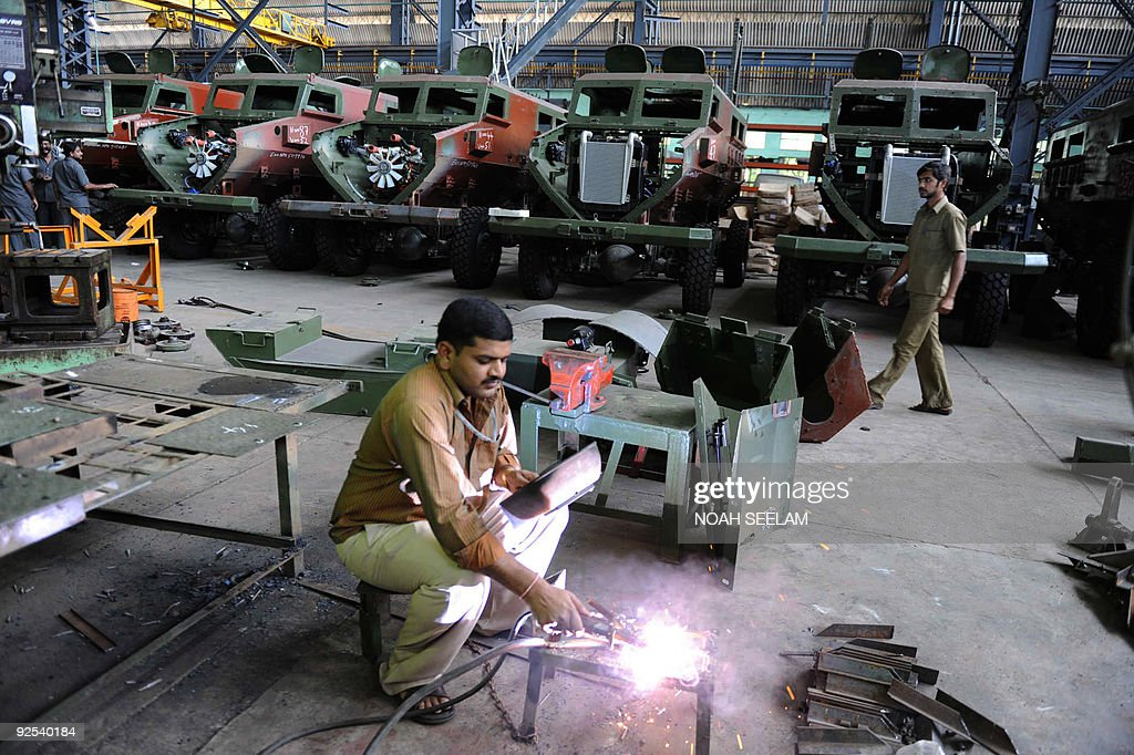 Indian factory workers makes parts for t : News Photo