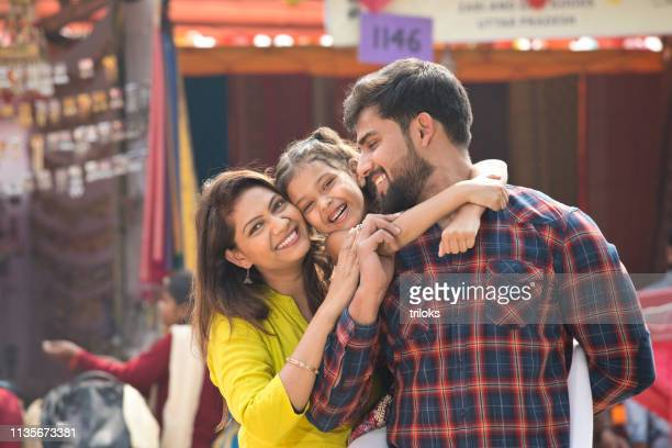 indian family at street market - south asia stock pictures, royalty-free photos & images