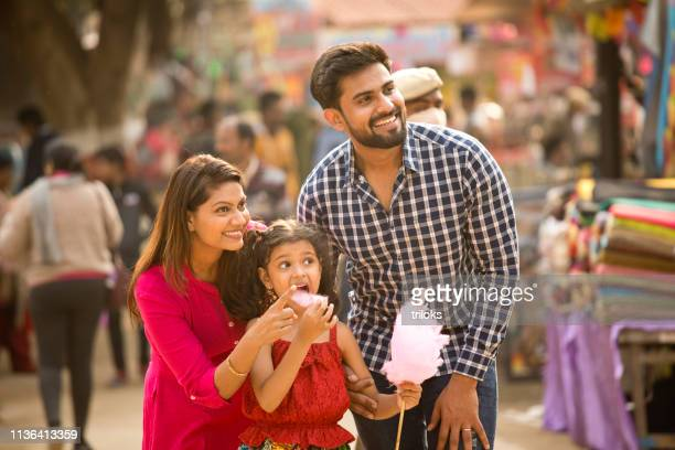 indian family at street market - indian culture stock pictures, royalty-free photos & images