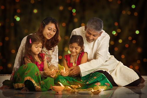 Indian family celebrating Diwali, fesitval of lights 487408618