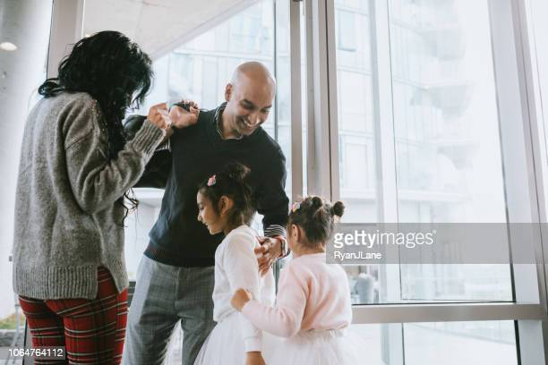 indian family greeting father home from work - indian culture stock pictures, royalty-free photos & images