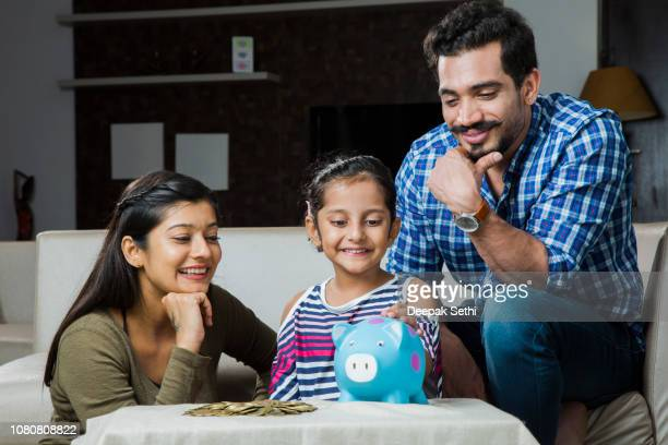 indian family - stock images - rescue stock pictures, royalty-free photos & images