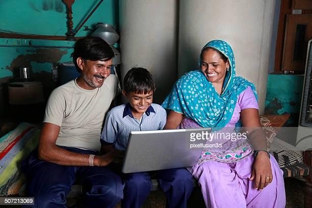 Indian Family Using Laptop