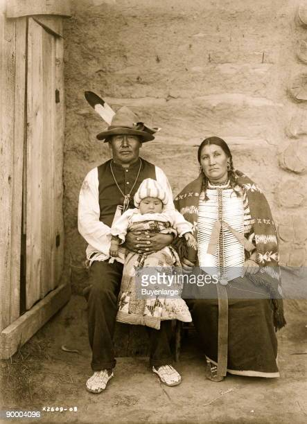 Indian family woman and man in native dress holding baby