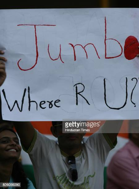 Indian fan holding placard asking Anil Kumble to come back on the fourth day of the first test match between India and Sri Lanka at Sardar Patel...