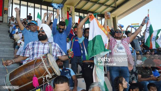 Indian fans celebrate a wicket during game one of the One Day International series between New Zealand and India at McLean Park on January 23, 2019...