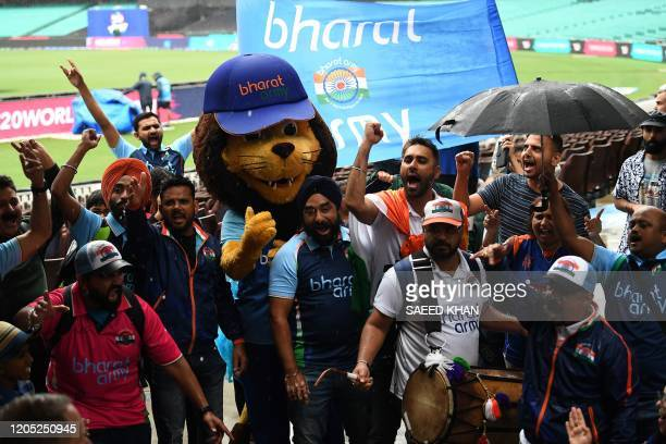 Indian fans celebrate as India's team qualify for the Twenty20 women's World Cup cricket final in Sydney on March 5, 2020. - India reached a maiden...