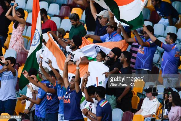 Indian fans celebrate during day five of the 4th Test Match in the series between Australia and India at The Gabba on January 19, 2021 in Brisbane,...