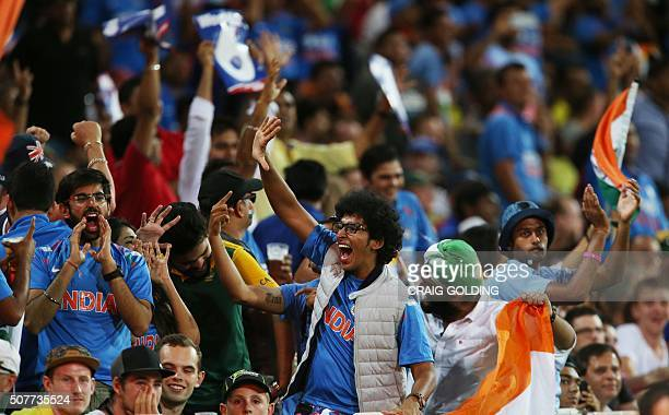Indian fans celebrate during the third Twenty20 international cricket match between India and Australia in Sydney on January 31 2016 GOLDING
