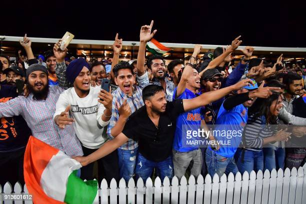 Indian fans celebrate their team's victory in the U19 cricket World Cup final match between India and Australia at Bay Oval in Mount Maunganui on...