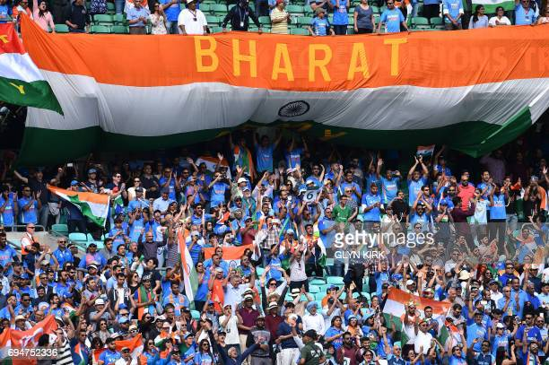 Indian fans cheer at the ICC Champions Trophy match between South Africa and India at The Oval in London on June 11 2017 / AFP PHOTO / Glyn KIRK /...