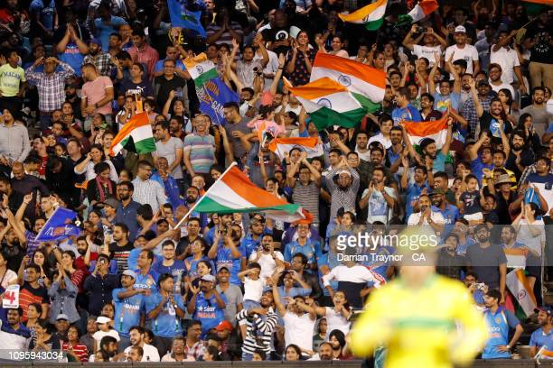 Indian fans cheer during game three of the One Day International series between Australia and India at Melbourne Cricket Ground on January 18, 2019...