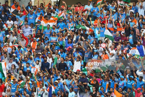 Indian fans cheer during the ICC Champions trophy cricket match between India and South Africa at The Oval in London on June 11 2017