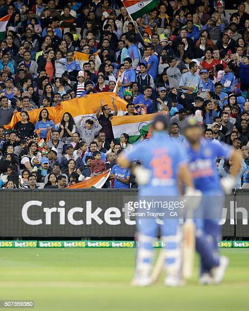 Indian fans cheer during the International Twenty20 match between Australia and India at Melbourne Cricket Ground on January 29, 2016 in Melbourne,...