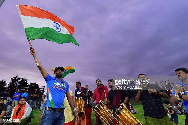 Indian fans cheer on their team during the U19 cricket World Cup final match between India and Australia at Bay Oval in Mount Maunganui on February 3...