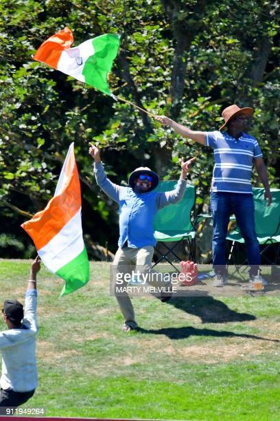 Indian fans dance after Pakistan's Zaid Alam was caught during the U19 semifinal cricket World Cup match between India and Pakistan at Hagley Oval in...