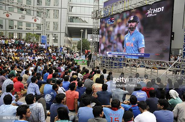 Indian fans enjoy the live telecast of the India vs Australia Cricket World cup semifinal match on a big screen at Cyber Hub on March 26 2015 in...