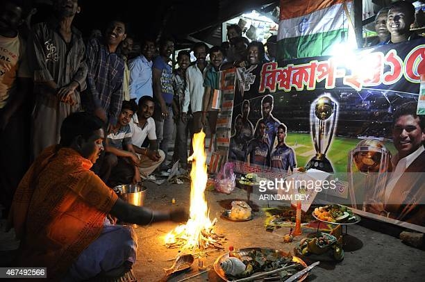 Indian fans gather for prayers for the success of the Indian cricket team on the eve of their Cricket World Cup semifinal match against Australia in...