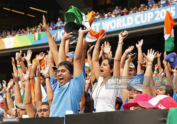 Indian fans in the crowd celebrate during the 2015 ICC Cricket World Cup match between South Africa and India at Melbourne Cricket Ground on February...