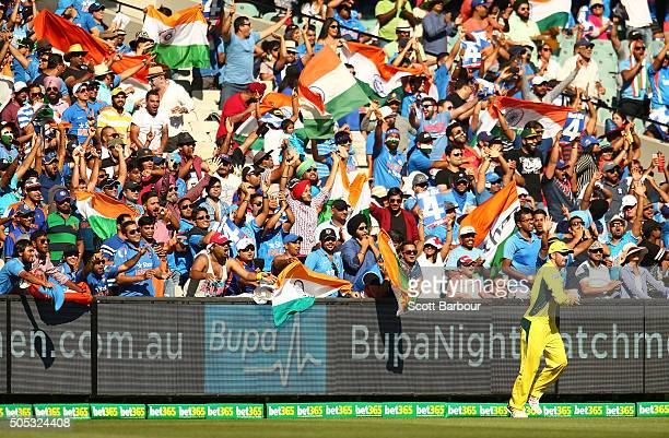Indian fans in the crowd show their support during game three of the One Day International Series between Australia and India at the Melbourne...