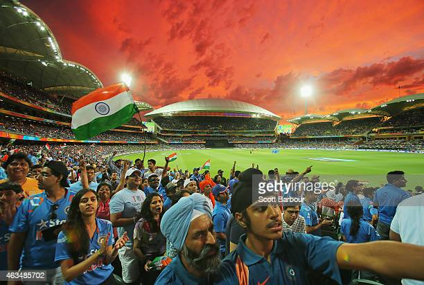 Indian fans in the crowd wait for a DRS decision to display on the large screen as they watch the match during the 2015 ICC Cricket World Cup match...