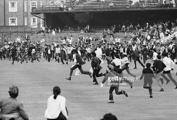 Indian fans invade the pitch at the Oval, London, 25th August 1971, after India won the Third Test against England by four wickets to win the test...
