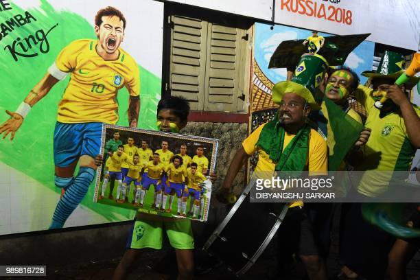 TOPSHOT Indian fans of Brazilian football team celebrate during the FIFA 2018 World Cup last 16 football match between Brazil and Mexico in Kolkata...