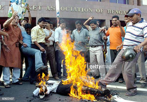 Indian fans of suspended Indian cricket team captain Sourav Ganguly burn an effigy of International Cricket Council umpire Chris Broad after he...