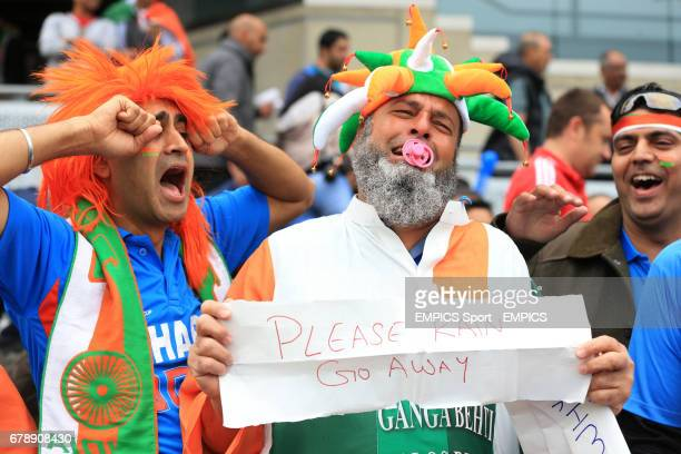 Indian fans pray for the rain to stop