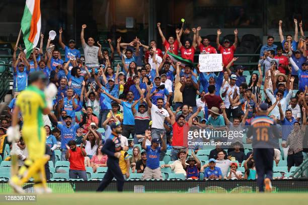 Indian fans react as Virat Kohli of India takes a catch to dismiss Aaron Finch of Australia during game two of the One Day International series...