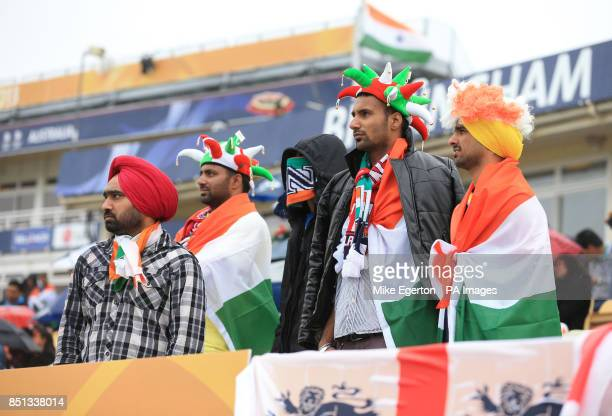 Indian fans shelter from the rain during the ICC Champions Trophy Final at Edgbaston Birmingham