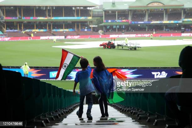 Indian fans show their colours as heavy rainfall delays play during the ICC Women's T20 Cricket World Cup Semi Final match between India and England...