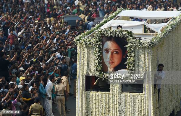 TOPSHOT Indian fans watch as the funeral cortege of the late Bollywood actress Sridevi Kapoor passes through Mumbai on February 28 2018 Thousands of...