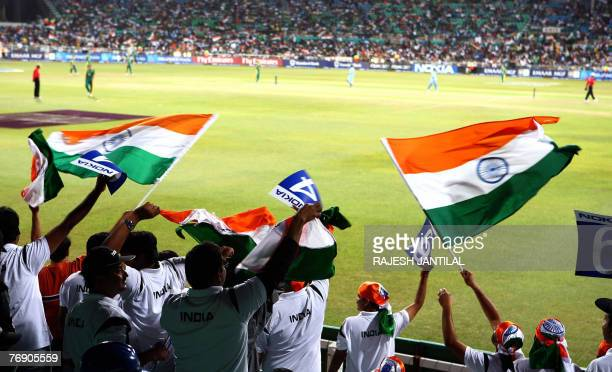Indian fans wave flags during the Twenty20 Cricket World Championship match between India and South Africa the at the Kingsmead stadium in Durban 20...